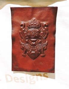 3-D LEATHER: Turkish tag and label company KT Label has developed washable and dry-cleanable leather tags that won't shrink or get brittle and with colors that won't run. The company has also developed a method for creating embossed leather tags that retain their design.