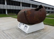 From Above: A 500-pound, stainless steel piece of space debris, which landed in Texas in 1997, is on display at Aerospace Corp.'s campus in El Segundo.